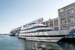 Big neutral yacht moored on the city`s waterfront side area of the town of Boston USA Massachusetts stock image