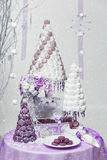 Big New Year's or wedding cake on lightly decorated background. Stock Photos