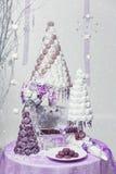 Big New Year's or wedding cake on lightly decorated background. Stock Photos