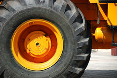 The big new yellow wheel Stock Photography
