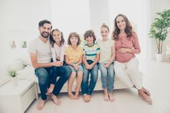 Big nice beautiful adorable adoptive lovely cheerful family in c royalty free stock images