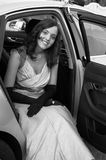 Big night. Woman sitting in car in evening wear Royalty Free Stock Photography