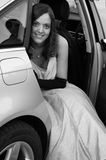Big night. Woman sitting in car in evening wear Royalty Free Stock Images
