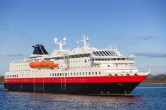 Big Norwegian passenger cruise ship in fjord. Big Norwegian passenger cruise ship goes on fjord stock image