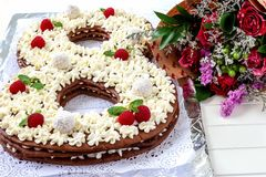 Big number cake and red rose flower. Cake shape of number 8 decorated white creamcheese, raspberry and coconut candy. Big number cake shape of 8 decorated white royalty free stock image
