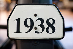 Big number 1938 digits. Sign plate with big number 1938 digits closeup stock photo