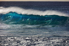 Big ocean wave in beautiful light. Surfing barrel ocean wave closing Stock Photo