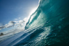 Big ocean wave in beautiful light. Vibrant ocean wave barrel for surfing Royalty Free Stock Photos