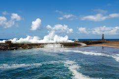 Big ocean waves breaking on the natural pool. Bajamar, Tenerife, Canary Islands, Spain. Royalty Free Stock Images