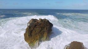 Big Ocean Waves Breaking on Rock stock footage