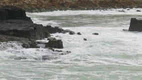 Big Ocean Waves Breaking on Rocks stock footage
