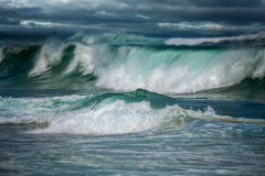 Big ocean waves in Dangerous storm. Dangerous stormy weather - dramatic seascape - dark clouds and big ocean waves Stock Photo