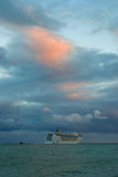 Big oceanic ship sailing off from Yalta port at fall evening Stock Photography