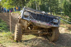 Big off road car is hitting a steep hil Stock Photography