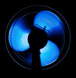 Big office fan in blue light. Isolated on black Stock Photos