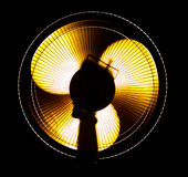Big office fan in yellow light Royalty Free Stock Photography