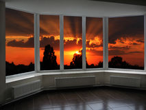 Big office windows with sunset beyond it Stock Photos