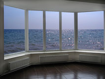 Big office windows with view of marine waves Royalty Free Stock Photos