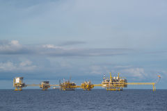 Big oil and gas production platfrom in ocean with blue sky Stock Image