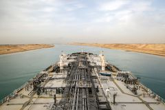 Oil tanker is proceeding through Suez Canal. Big oil product tanker is proceeding through Suez Canal Royalty Free Stock Photography