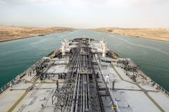 Big oil tanker is proceeding through Suez Canal. royalty free stock image
