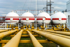 Big oil tanks in a refinery. Big industrial oil tanks in a refinery base Stock Photos