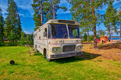Big Old American RV / Camping Car. In Pine Forest Setting Stock Photos