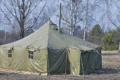 Big old army expedition tent in the forest. Big old army expedition tent in the autumn forest Royalty Free Stock Images