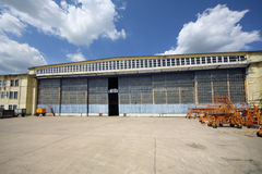 Big old battered aircraft hanger with big gate Royalty Free Stock Photos