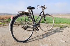 A big old bicycle in the rural environment Royalty Free Stock Photography