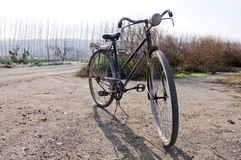 A big old bicycle in the rural environment Stock Photo
