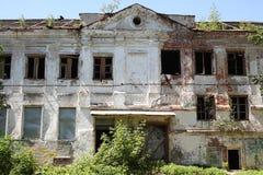 Big old brick burnt abandoned house with windows Stock Image