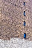 Big old brick wall with windows Royalty Free Stock Photos