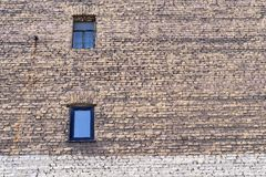 Big old brick wall with windows Stock Photos
