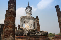Big old Buddha image. Sit on the haunches in old city, Sukhothai province, Thailand Royalty Free Stock Photo