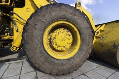Big old bulldozer tire. Part of a bulldozer big old tire on a repair site stock photography