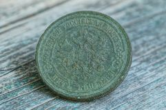 One big old green copper coin with an eagle royalty free stock images