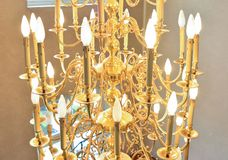Big old luxury chandelier. Big luxury chandelier with a lot of candles Stock Photography