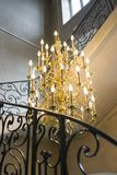 Big old luxury chandelier. Big luxury chandelier with lot of candles Stock Photography