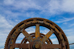 Big and Old Machinery Gears Stock Images