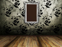 Big old mirror on the vintage wall Stock Photo