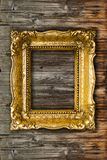 Big Old Retro Gold Picture Frame On Wooden Wall royalty free stock images