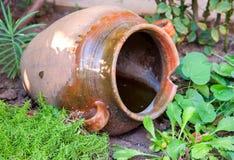 Big old retro jug in the garden Royalty Free Stock Image