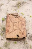 Big old rusty fuel jerrican. Or cannister at sand Royalty Free Stock Image