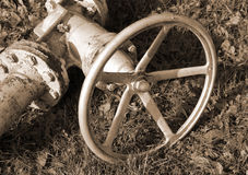 Big old shut-off valve with sepia effect Royalty Free Stock Photos
