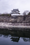 A big old stone wall and small castle of Osaka castle Royalty Free Stock Images