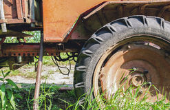 Big old tractor wheel. Closeup shot, selective focus Royalty Free Stock Photo