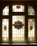 Big old window with beautiful colored murals Royalty Free Stock Photos