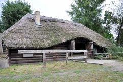 Big old wooden house for horses with a thatched roof. Royalty Free Stock Photography