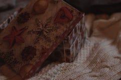 Big open christmas present box. On the woolen sweater stock photos
